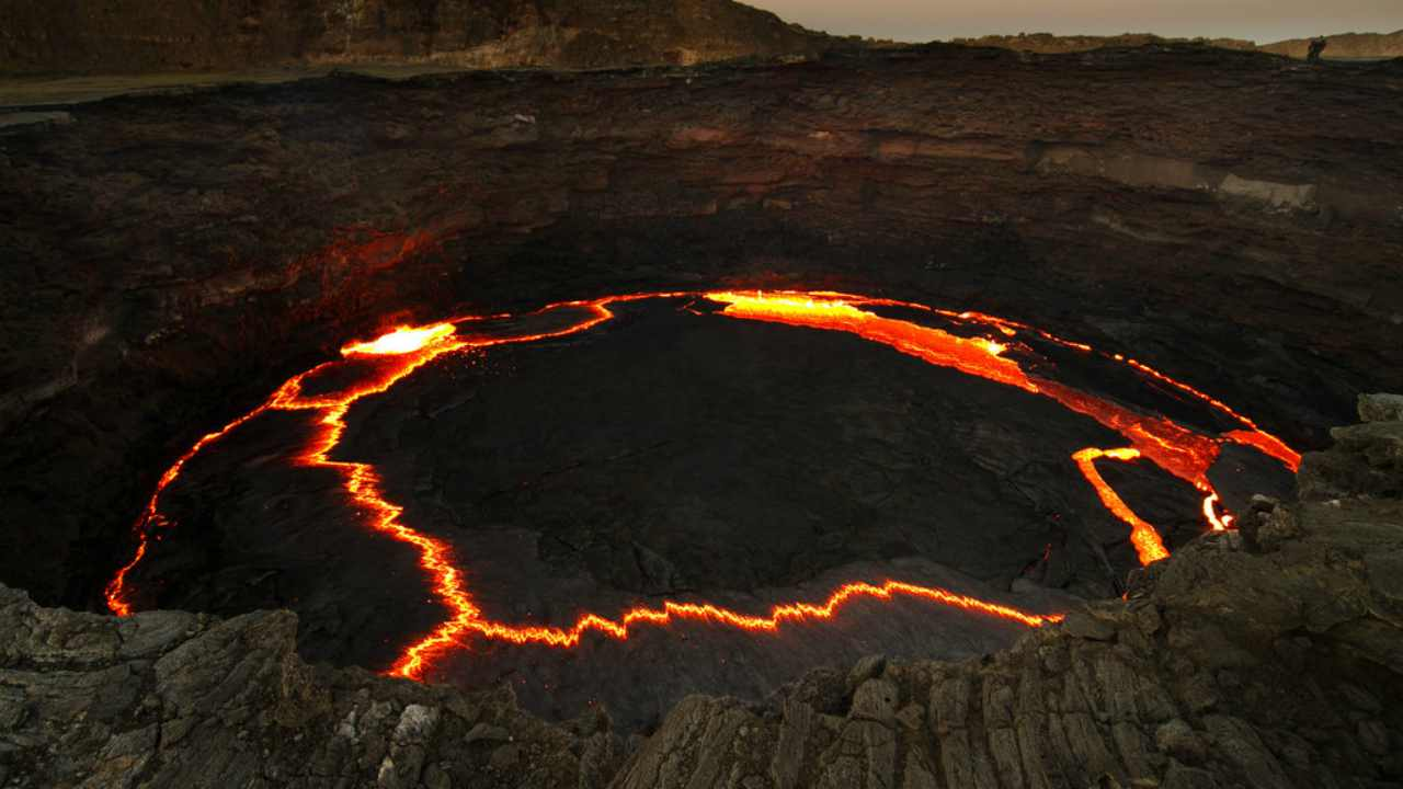 8. Erta Ale, Ethiopia | The volcano has been active since 1967 and has the record for the longest-existing lava lake. The name literally means 'smoking mountain', and the location is the driest, lowest and hottest places on the planet. (Image: Flickr)