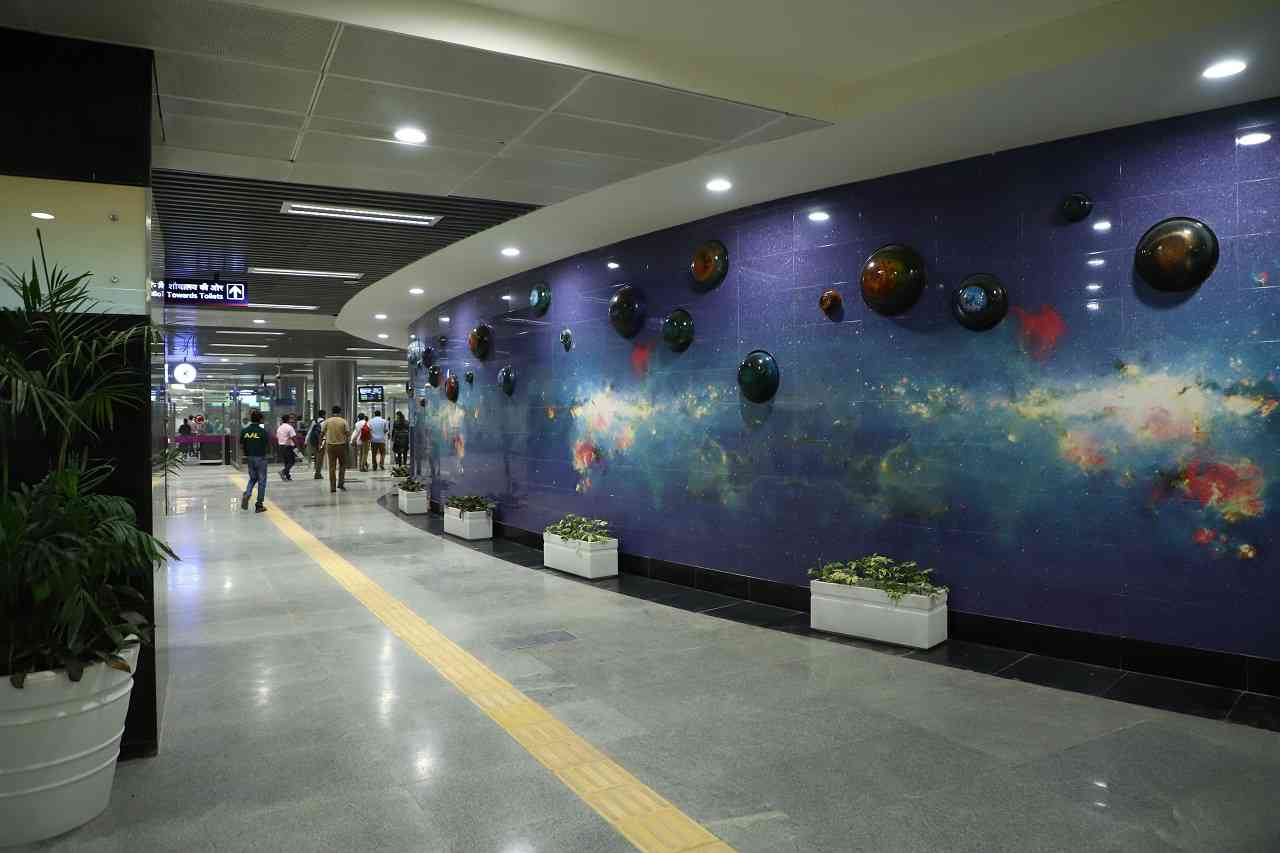 Artwork at the Metro station | Different themes have been used at different stations and a artists have been roped in. In Chirag Delhi, an artwork depicting butterflies has been installed since there is a nursery in the vicinity of the station. The artwork at GK Enclave depicts the many trends in fashion. At Palam, the ceiling of one of the entry/exit points has been decorated with special prints which depict the blue skies.