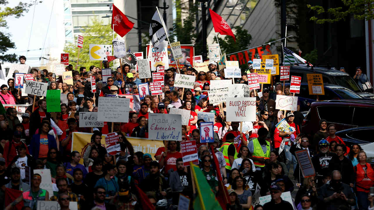 Demonstrators walk down Madison Street during the March for Immigrant and Workers Rights on May Day in Seattle, Washington, US. (Reuters)