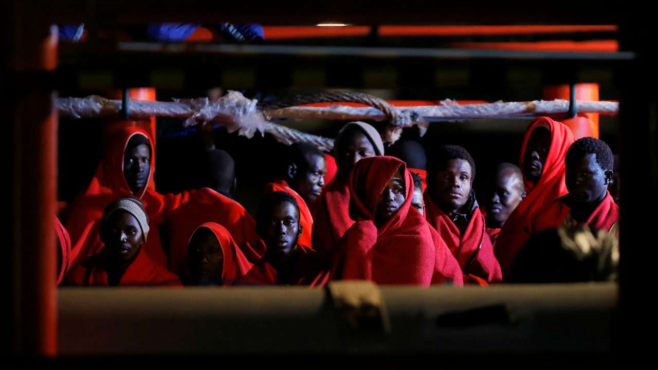 Migrants, part of a group intercepted aboard two dinghies off the coast in the Mediterranean Sea, rest on a rescue boat upon arrival at the port of Malaga, Spain. (Reuters)