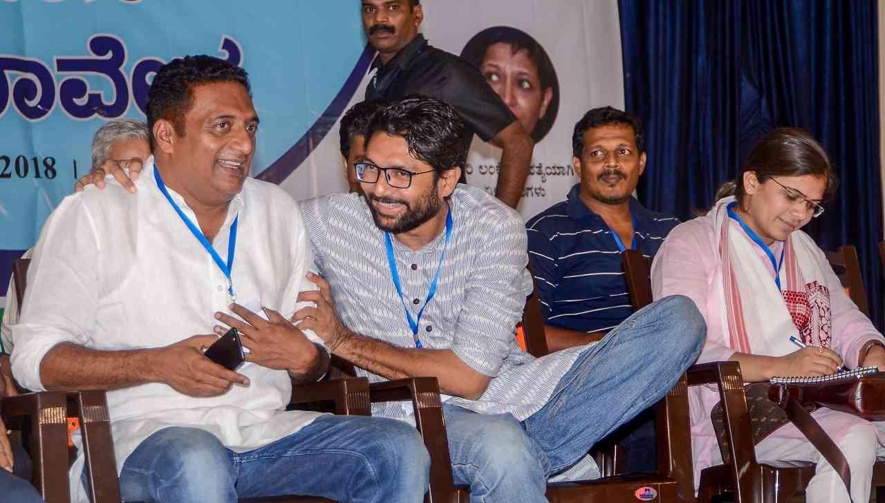 Mangaluru: Dalit leader Jignesh Mevani shares a light moment with actor Prakash Raj during Swabhimana Samavesh in Thokkuttu, near Mangaluru on April 28 2018.