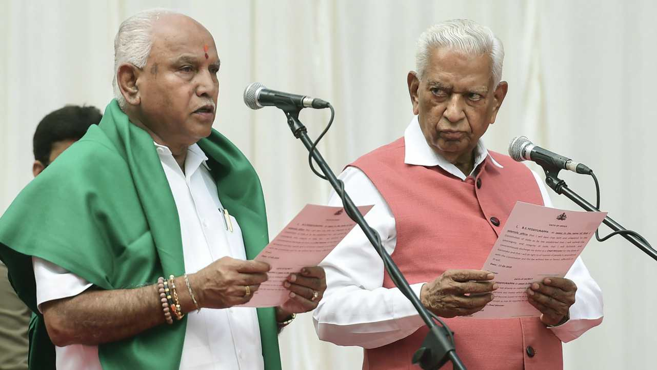 Karnataka Governor Vajubhai Vala administers oath to Bharatiya Janata Party (BJP) leader BS Yeddyurappa as Chief Minister of the state at a ceremony in Bengaluru on Thursday. (PTI)