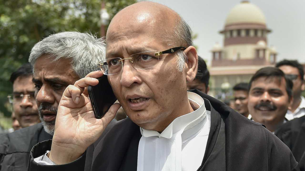 Senior Congress leader and Advocate Abhishek Singhvi leaves after a hearing in Karnataka government formation case, at Supreme Court in New Delhi, on Friday. The Supreme Court ordered a floor test to be conducted in the Karnataka Assembly on Saturday for BJP's B S Yeddyurappa, who was sworn-in as Chief Minister, to prove his majority. (PTI)
