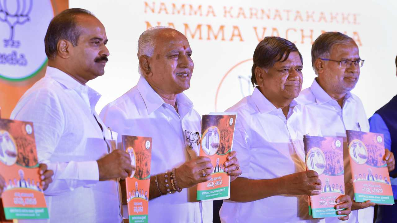 Karnataka BJP President B S Yeddyurappa, MP PC Mohan, Jagadish Shettar and Suresh Kumar release the party's manifesto for the upcoming Assembly polls in Bengaluru on Friday. (PTI)