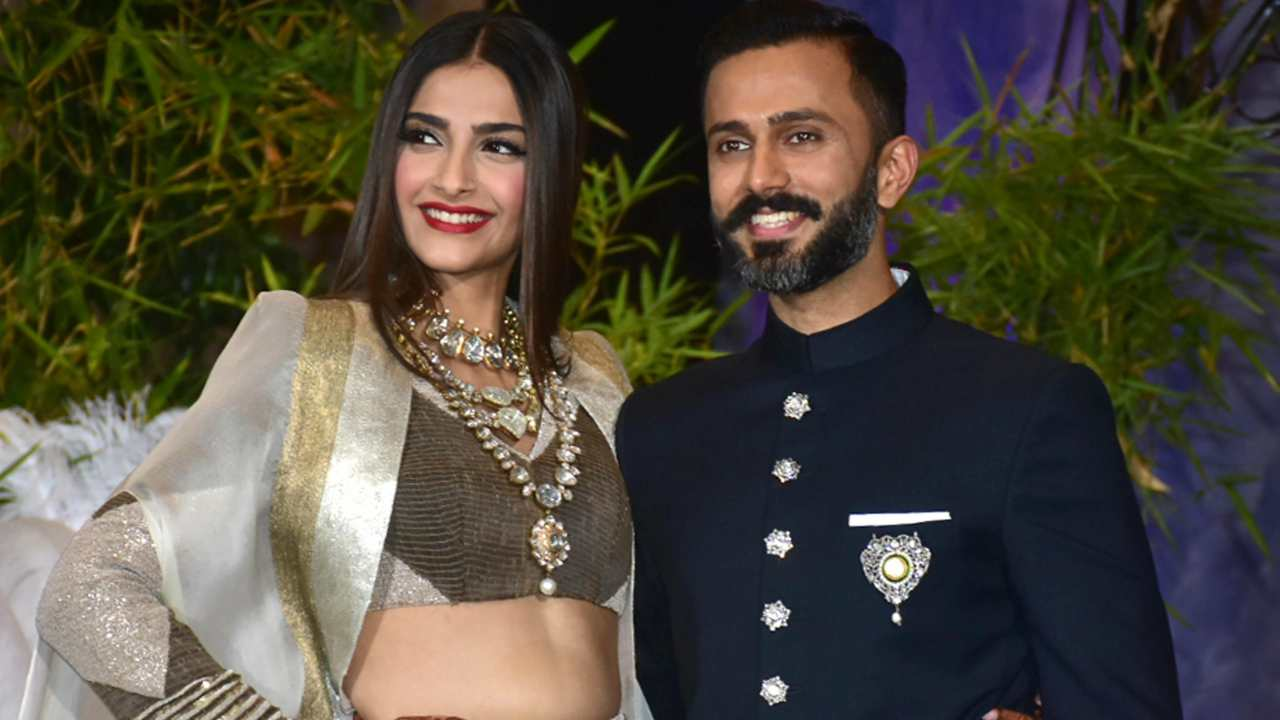 Bollywood Actress Sonam Kapoor with her husband Anand Ahuja pose for a photograph during their wedding reception in Mumbai on Tuesday. (PTI)