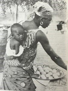 Q11. The picture shows a mother carrying her baby on her back. This picture inspired Ann Moore to design a carrier which could hold baby facing the mother thereby creating an emotional bond. What did she create?