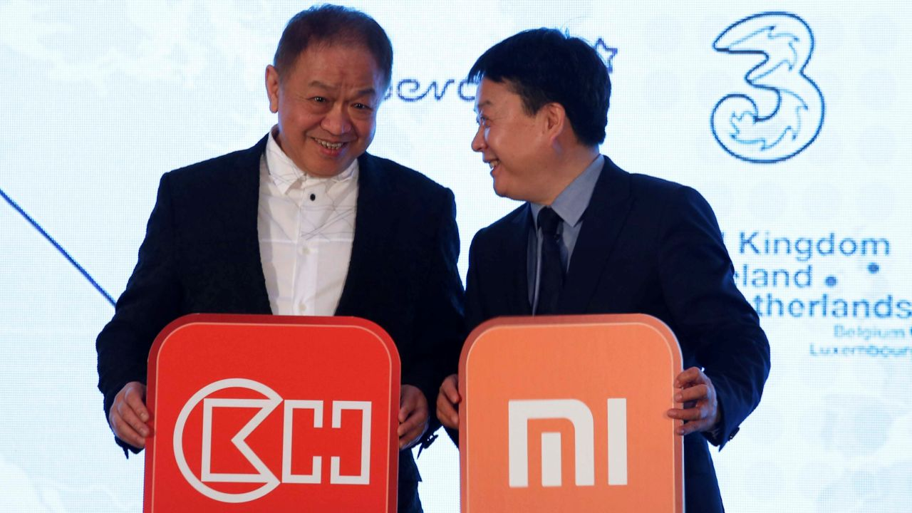 CK Hutchison Holdings Executive Director and Group Co-Managing Director Canning Fok and Xiaomi Senior Vice President Wang Xiang chat during an event announcing a strategic alliance in Hong Kong, China. (Reuters)