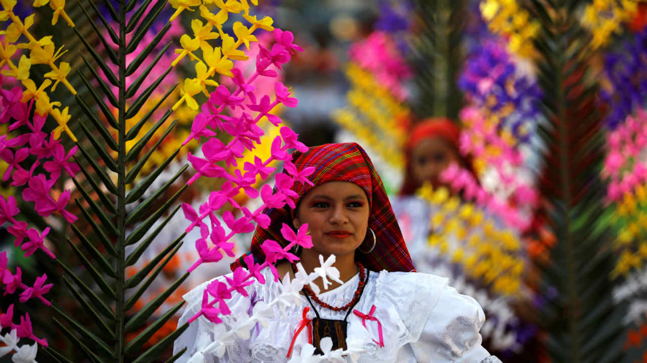 A girl dressed in traditional costumes takes part in the festivity of the Holy Cross to ask for a good rainy season in Panchimalco, El Salvador. (REUTERS)