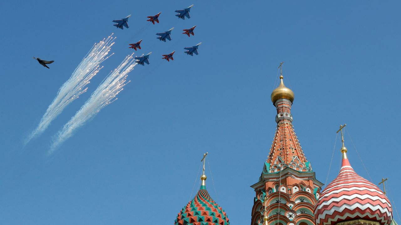 Russian army MiG-29 jet fighters of the Strizhi (Swifts) and Su-30 jet fighters of the Russkiye Vityazi (Russian Knights) aerobatic teams fly in formation during the rehearsal for the Victory Day parade, with St. Basil's Cathedral and a bird seen in the foreground, in central Moscow, Russia. (Reuters)
