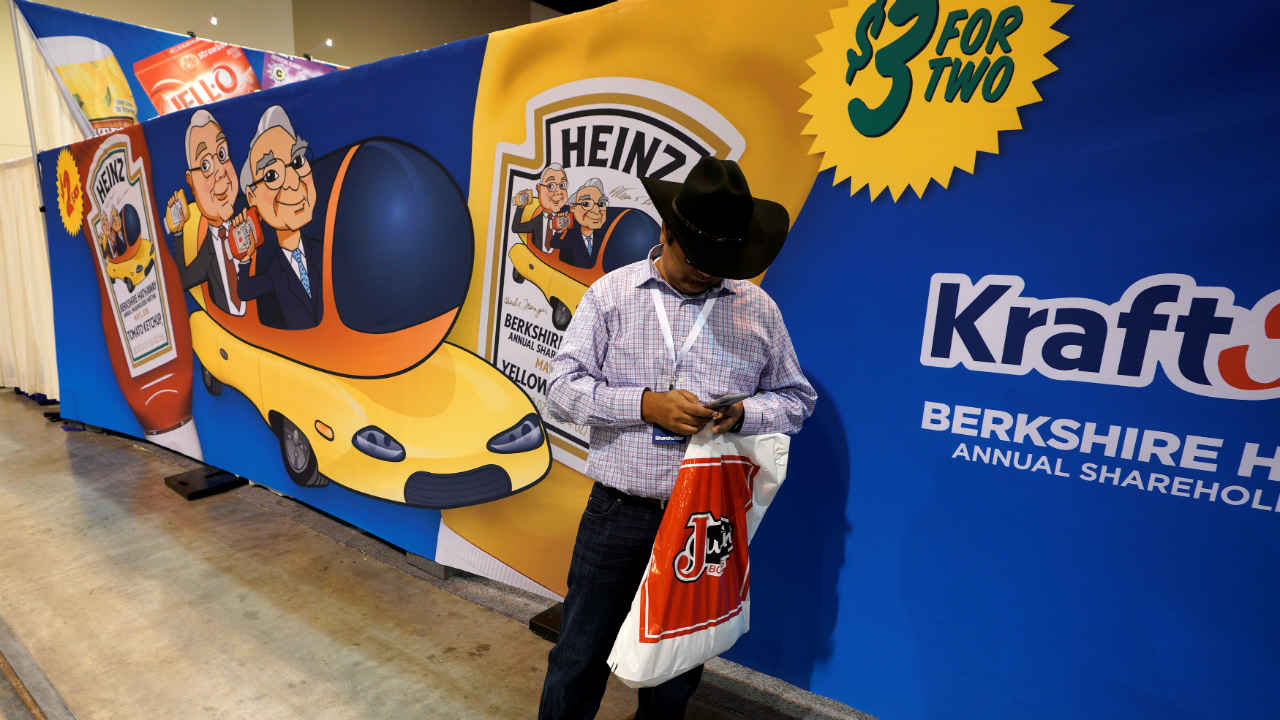 Even the heads of Berkshire Hathaway are turned into light-hearted animations backing up the products they have carefully invested in over the decades. Pictured here is a shareholder standing in front of a commemorative Heinz ketchup and mustard exhibit. The Berkshire AGM is called the largest company event in corporate America. (Image: Reuters)