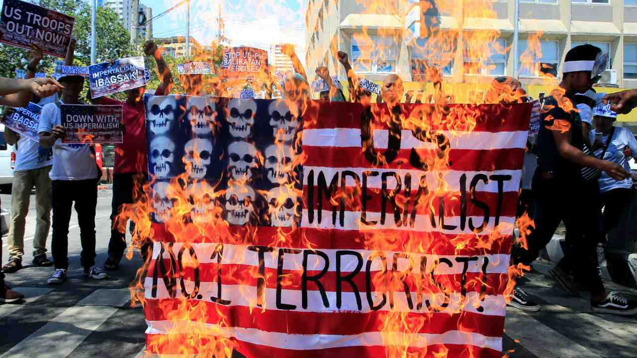 Protesters burn a mock of the U.S. flag to denounce the Philippines and United States 'Balikatan' (shoulder-to-shoulder) military field exercises during a protest in front of the US Embassy in Metro Manila, Philippines. (Reuters)