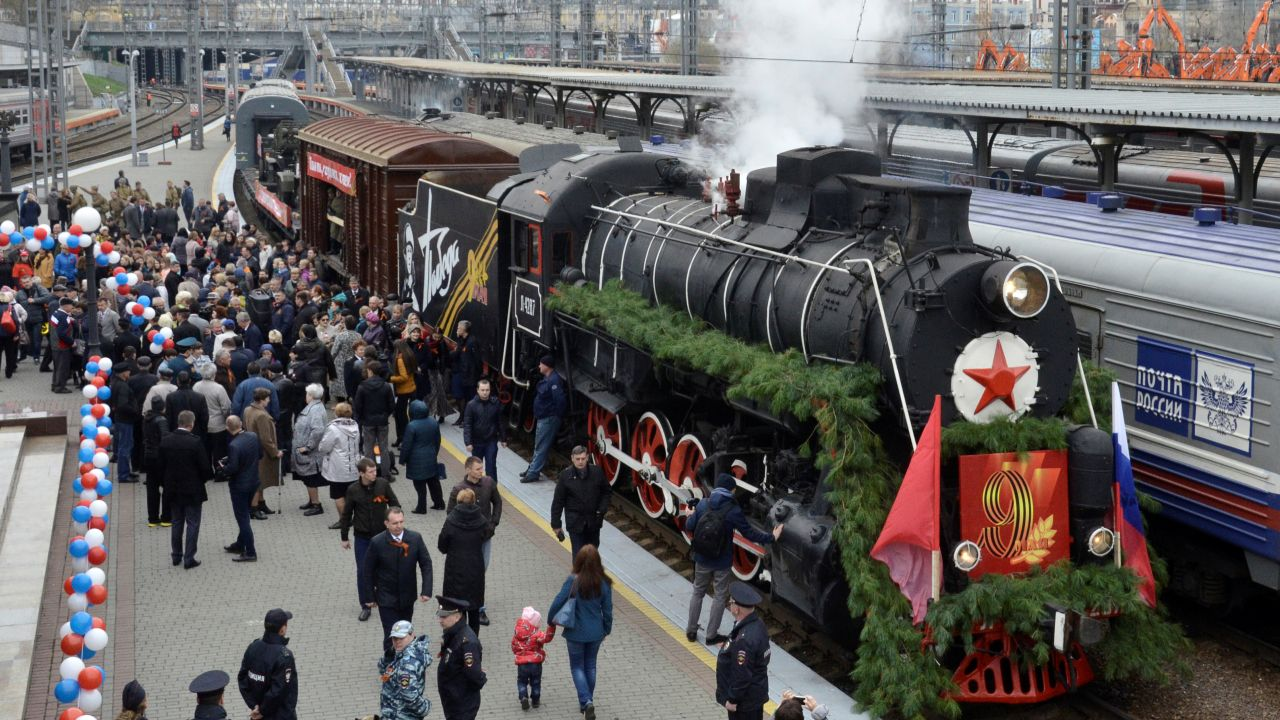 People gather near the retro train named Pobeda (Victory) during the Victory Day celebrations in the far eastern city of Vladivostok, Russia. (Reuters)