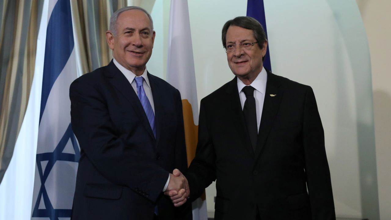 Cypriot President Nicos Anastasiades and Israeli Prime Minister Benjamin Netanyahu shake hands during a meeting at the Presidential Palace in Nicosia, Cyprus. (Reuters)