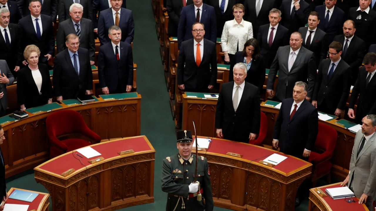 Members of parliament stand during the ceremony of taking the oath of office at the opening session after the recent election in Budapest, Hungary. (Reuters)