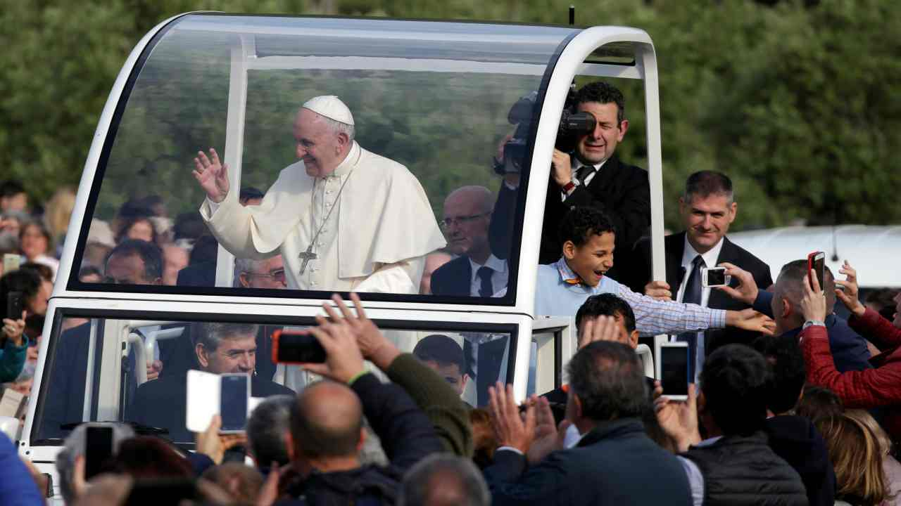 Pope Francis waves during his pastoral visit in Nomadelfia, central Italy. (Reuters)
