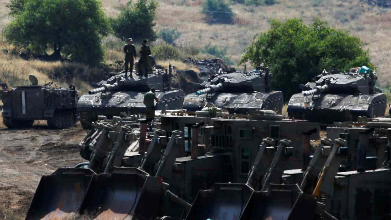 Israeli soldiers stand on tanks in the Israeli-occupied Golan Heights, Israel. (Reuters)