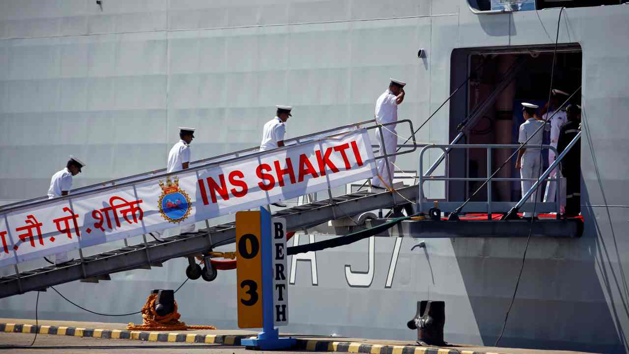 Naval officers board the INS Shakti, a fleet replenishment tanker of the Indian Navy, docked in Changi Naval Base during a visit to Singapore. (Reuters)