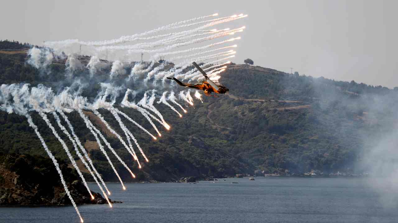 A Turkish Army helicopter takes part in a live fire drill during the EFES-2018 Military Exercise near the Aegean port city of Izmir, Turkey. (Reuters)