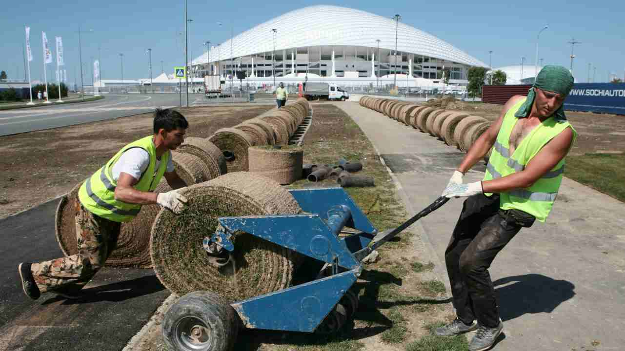 Employees place layers of lawn outside the Fisht Stadium in Sochi, the host city for the 2018 FIFA World Cup, Russia. (Reuters)