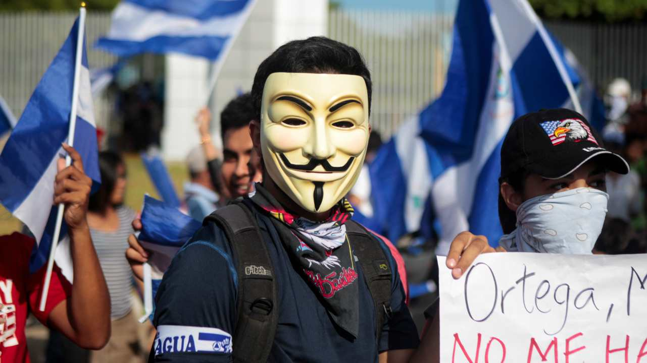 A protester wearing a Guy Fawkes mask takes part in a protest against Nicaraguan President Daniel Ortega's government in Managua, Nicaragua. (Reuters)
