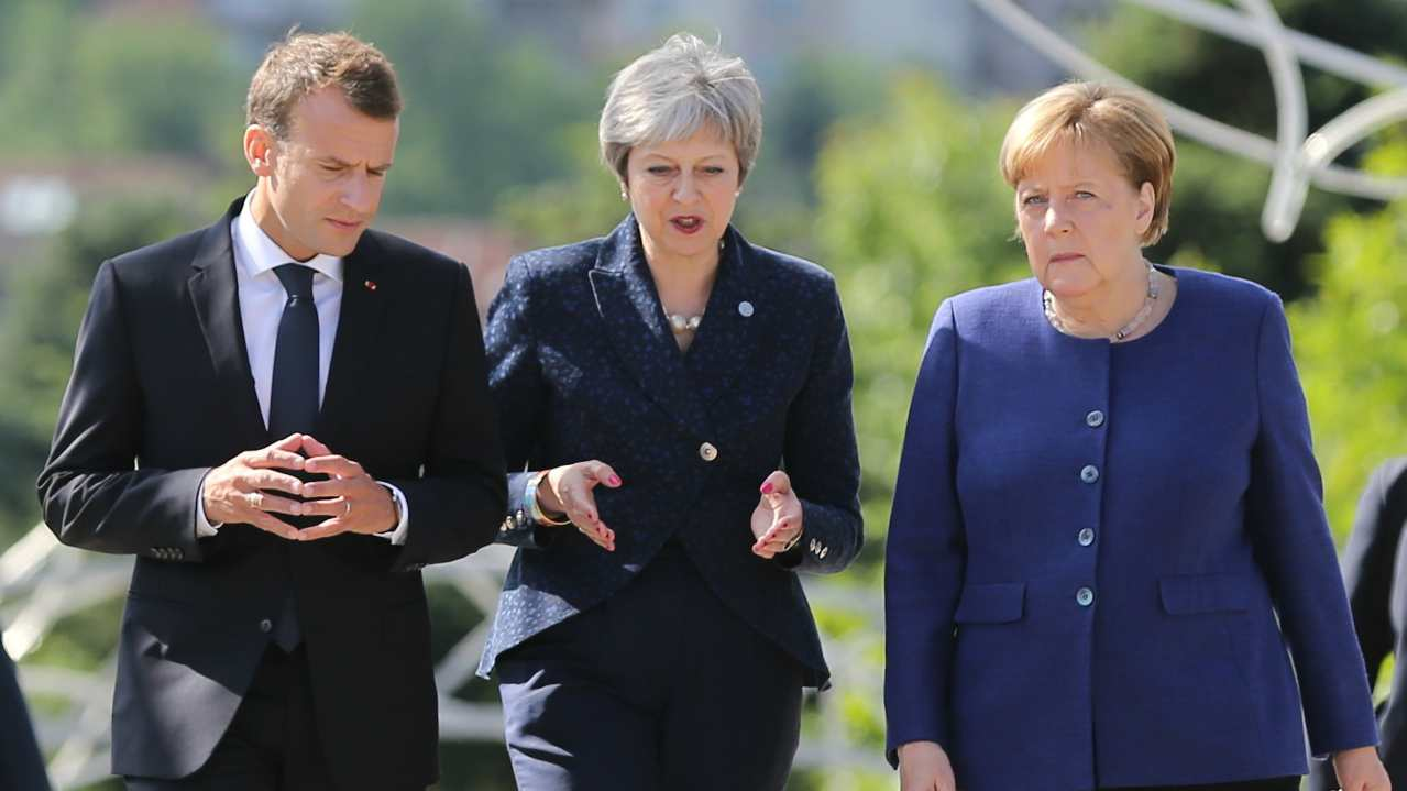 French President Emmanuel Macron, British Prime Minister Theresa May and German Chancellor Angela Merkel walk during the EU-Western Balkans Summit in Sofia, Bulgaria. (Reuters)