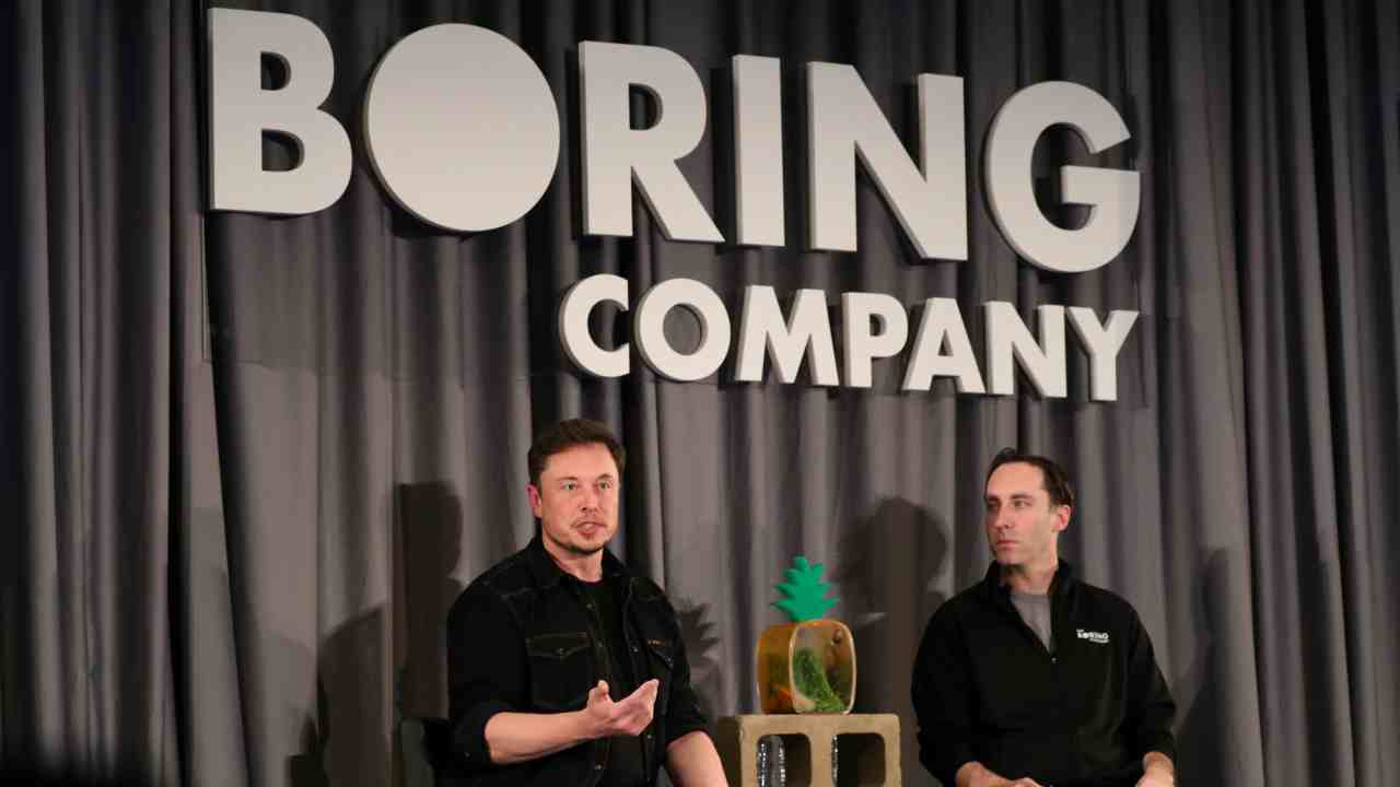 Elon Musk (L) speaks at a Boring Company community meeting in Bel Air, Los Angeles, California, US. (Reuters)