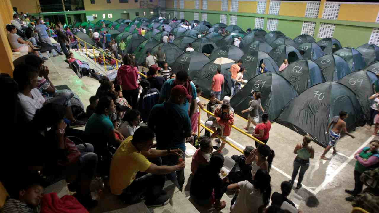 People rest at the municipal coliseum after the Colombian government ordered the evacuation of residents living along the Cauca river, as construction problems at a hydroelectric dam prompted fears of massive flooding, in Valdivia, Colombia. (Reuters)