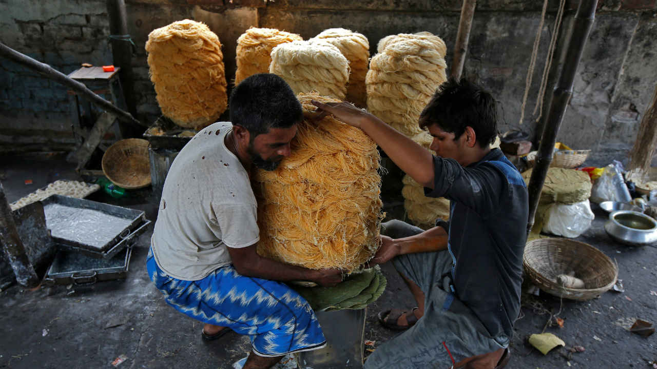 Workers pack vermicelli, a specialty eaten during the holy month of Ramadan, at a factory in Kolkata. (REUTERS)