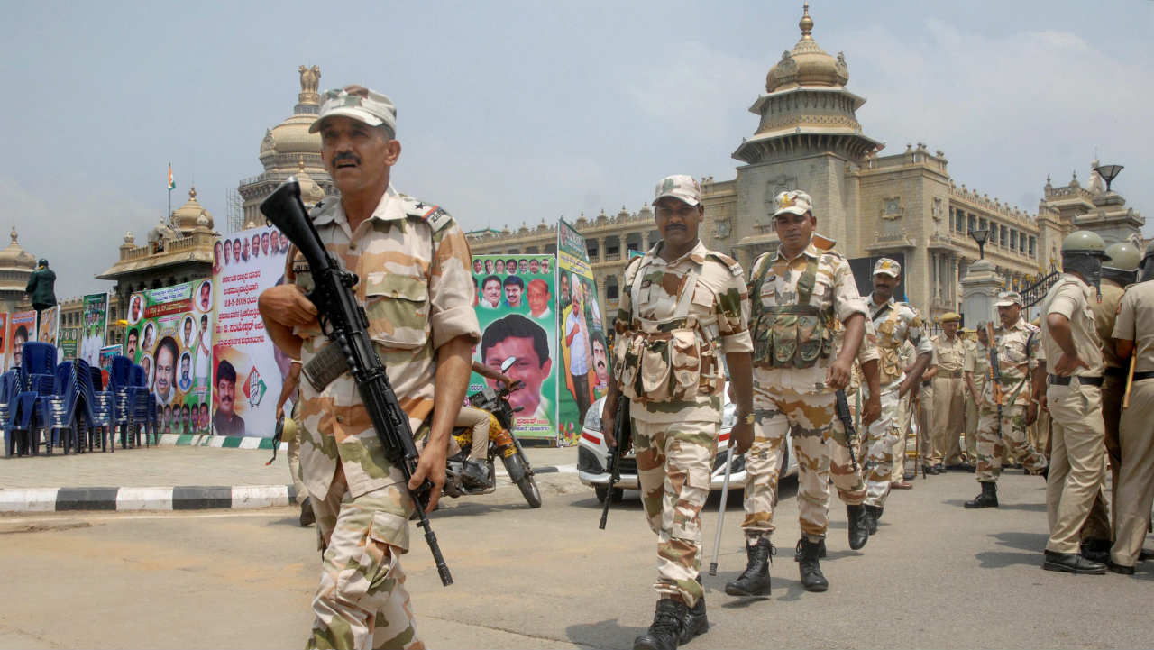 Central Industrial Security Force (CISF) personnel outside Vidhana Soudha ahead of the swearing-in ceremony the Janata Dal (Secular) and Congress coalition government, in Bengaluru on Wednesday. (PTI)