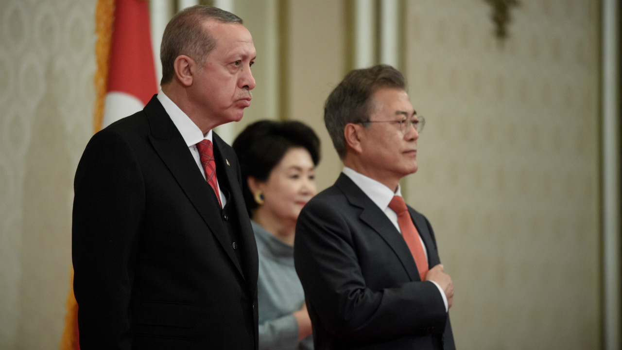 Turkey's President Recep Tayyip Erdogan stands with South Korea's President Moon Jae-in during a welcoming ceremony at the presidential Blue House in Seoul, South Korea. (Reuters)