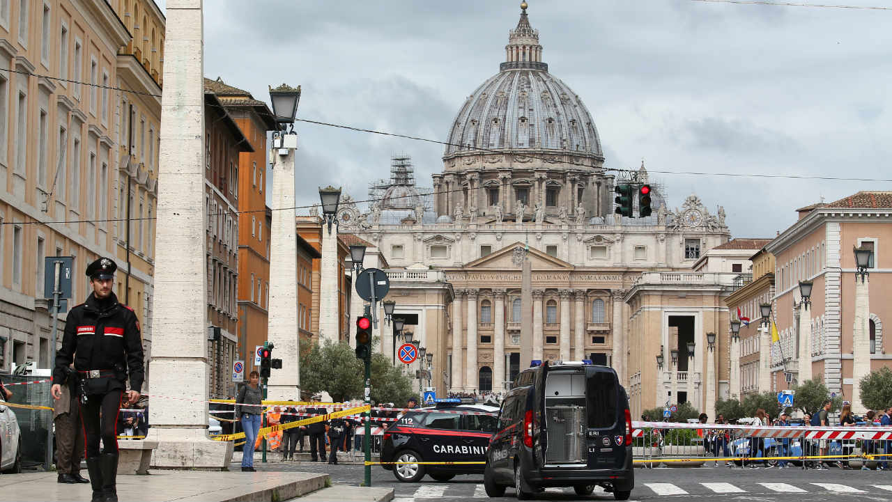 Carabinieri's officers patrol the area after a bomb alert in a bank on the road leading to the Vatican in Rome, Italy. (Reuters)