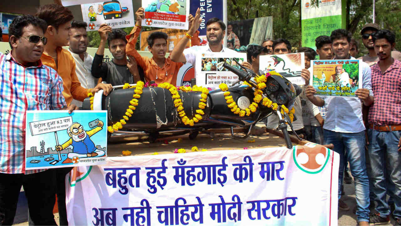 Youth Congress activists demonstrate against the fuel price hike, in Bhopal, on Wednesday. (PTI)