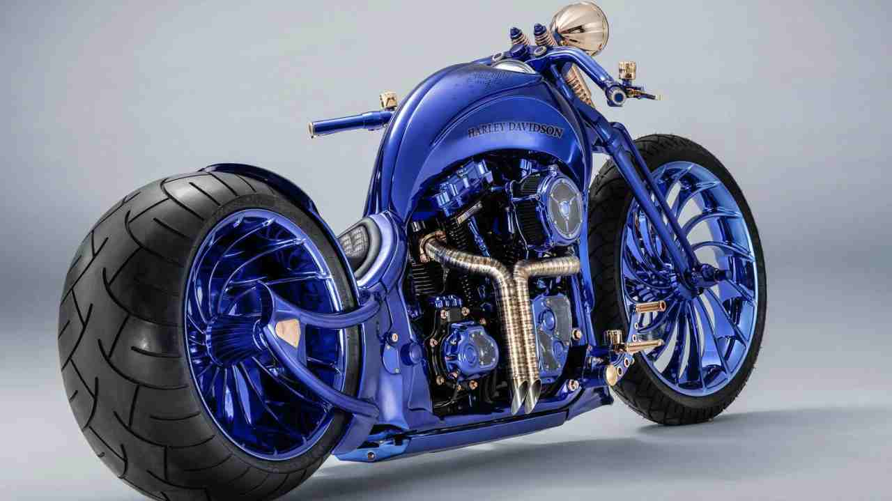 """Not surprisingly, it gets its name because the bike has been coated in six coats of different colours layered atop each other, with blue being the outer layer. The tank gets a custom """"Harley-Davidson"""" script above the """"BLU/EDITION"""" logo shared by Bucherer's other 17 high-end watches in the Blue Edition collection."""