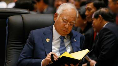 Former PM Najib, wife banned from leaving Malaysia: Immigration chief
