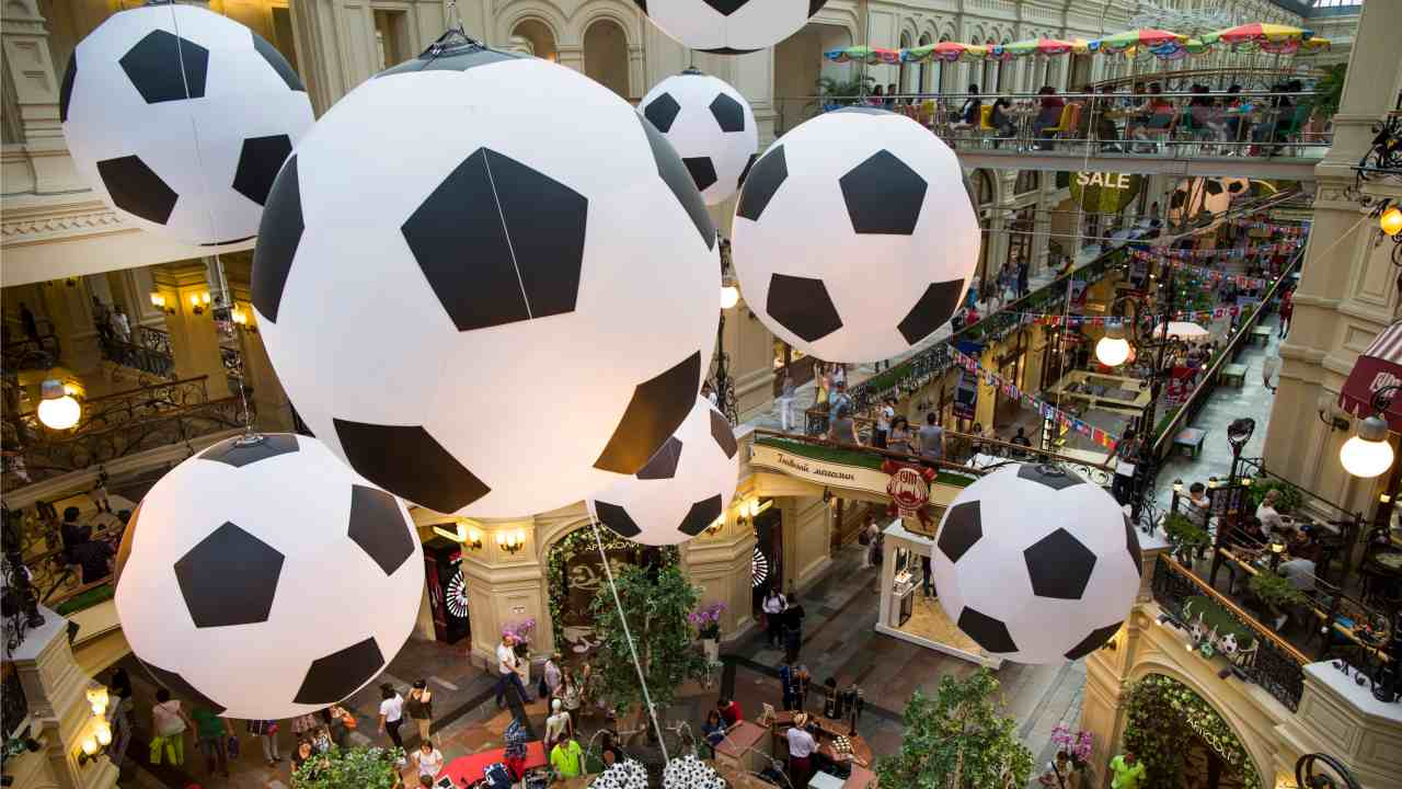 Tourists and soccer fans walk in the State Shop, GUM, decorated with giant soccer balls during the 2018 soccer World Cup in Moscow, Russia. (AP/PTI)