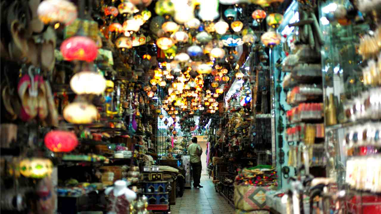 A visitor looks at traditional light-shop in local souq at Bab al Bahrain in Manama, Bahrain. (Reuters)