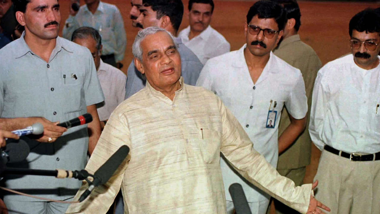 Vajpayee continued to lead the BJP through a string of defeats for more than a decade before finally winning the 1996 general elections to become India's 10th Prime Minister. After being unable to secure a coalition majority, Vajpayee resigned after 13 days. (Pictured - Vajpayee is seen here speaking to the press at New Delhi's Presidential palace, after submitting his resignation in 1996. (Image: Reuters)