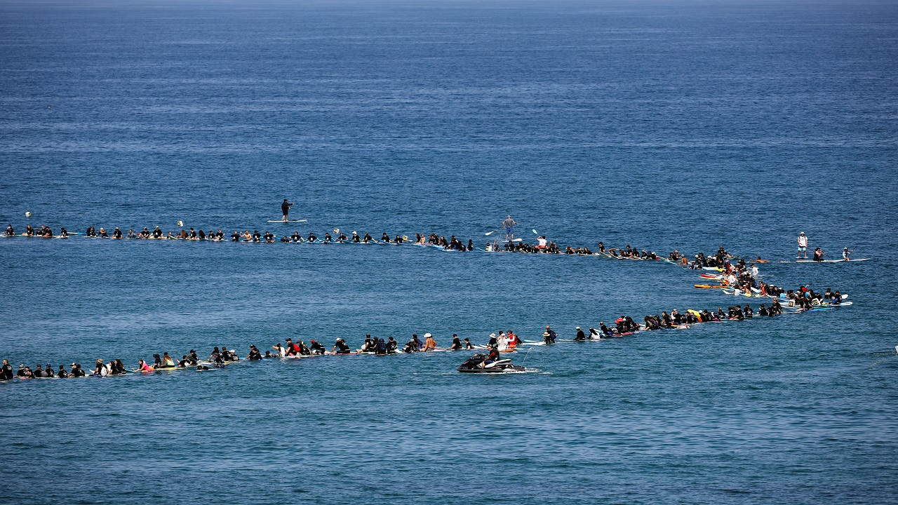 Hundreds of Israeli surfers take part in what they said was a record-breaking protest against potential environmental damage from an off-shore gas development project in the Mediterranean Sea at Herzliya, Israel. (Image: Reuters)