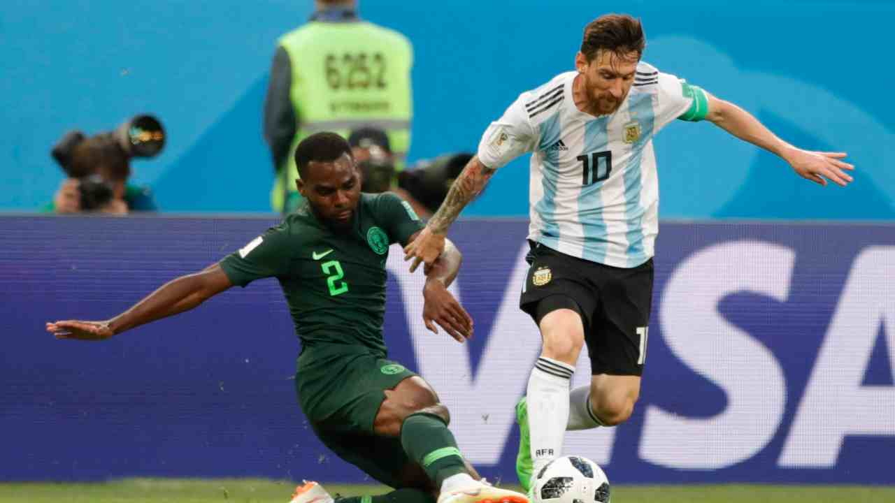 Argentina's Lionel Messi challenges for the ball with Nigeria's Bryan Idowu during the group D match between Argentina and Nigeria, at the 2018 soccer World Cup in the St. Petersburg Stadium in St. Petersburg, Russia.(AP/PTI)