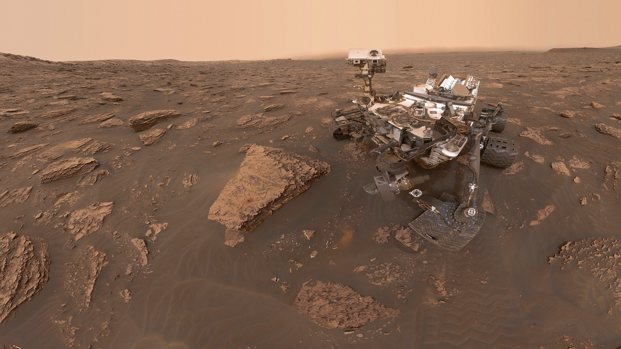 This composite image made from a series of June 15, 2018 photos shows a self-portrait of NASA's Curiosity Mars rover in the Gale Crater. The rover's arm which held the camera was positioned out of each of the dozens of shots which make up the mosaic. A dust storm has reduced sunlight and visibility at the rover's location.(Image:PTI)