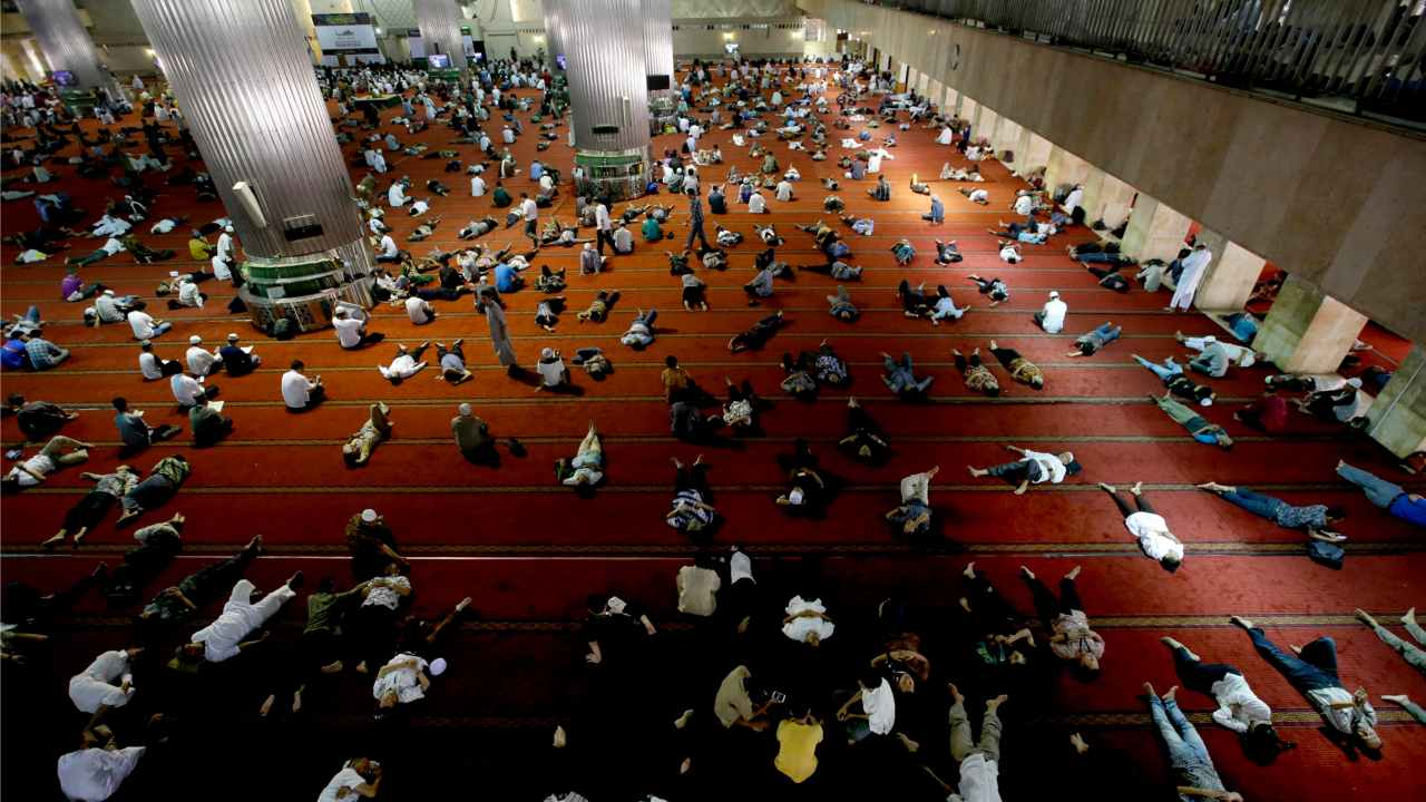 Muslim men rest as they wait to break their fast after Friday prayer at the Istiqlal Mosque in Jakarta, Indonesia. Muslims across the world are observing the holy fasting month of Ramadan, where they refrain from eating, drinking and smoking from dawn to dusk. (AP/ PTI)