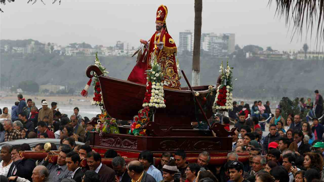 Fishermen carry a statue of Saint Peter in a boat during a procession in honor of the patron saint of fishermen in Lima, Peru. (AP/PTI)