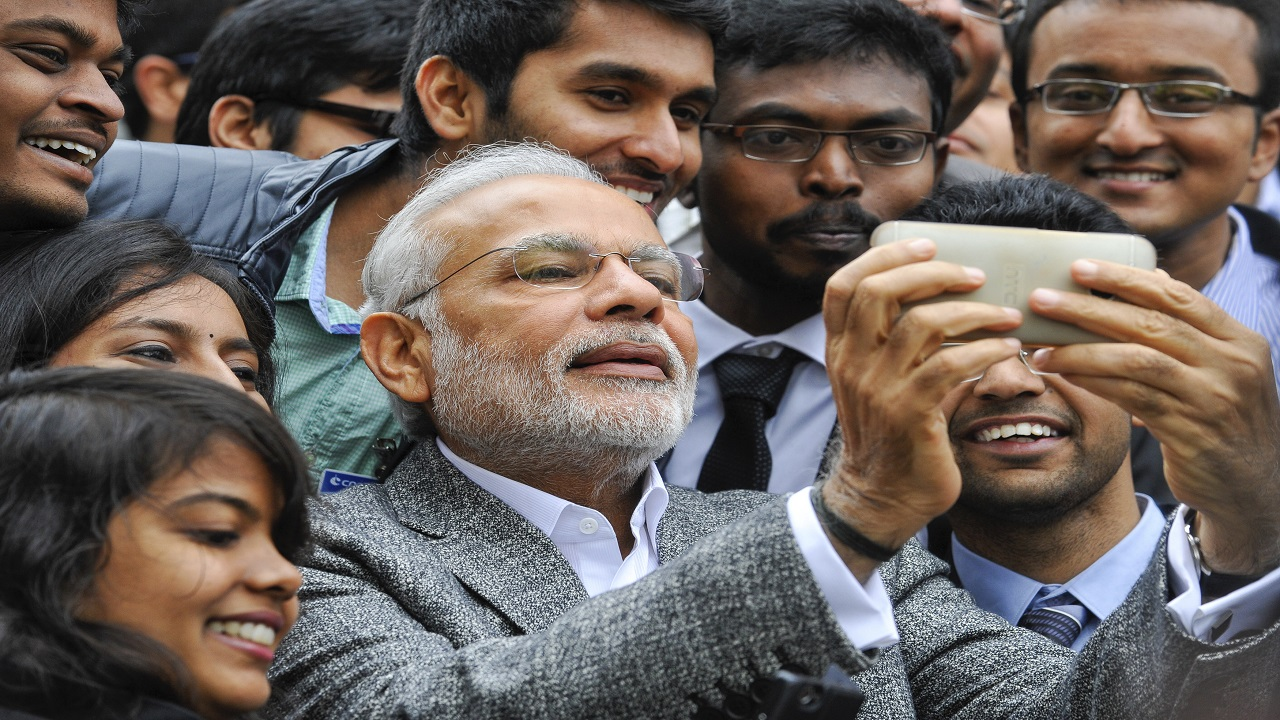 Before the Delhi assembly elections in 2015, the BJP set up around 1000 booths across the city where people could click a selfie with a virtual image of Narendra Modi. Over half-a-million selfies were clicked at these booths. (Image: Reuters)