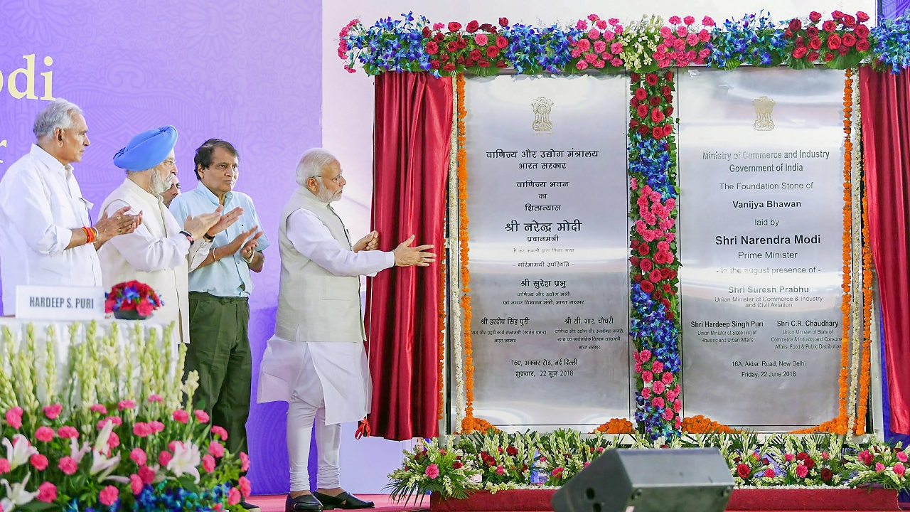 Prime Minister Narendra Modi unveils a plaque to mark the foundation stone laying ceremony of the upcoming office complex for the Commerce Department, 'Vanijya Bhawan', at Akbar Road in New Delhi. (Image: PTI)
