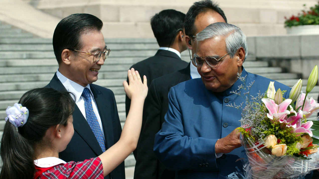 The Vajpayee government was known for carrying out a full-scale diplomatic peace process with Pakistan through late 1998 and early 1999. This was kick-started with the inauguration of the Delhi-Lahore bus service in February 1999. (Pictured - He is seen here being greeted by a Chinese girl and Chinese Premier Wen Jiabao during a welcoming ceremony in 2003. Image: Reuters)