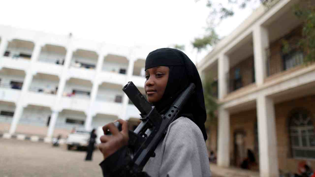 A girl displaced by the fighting in the Red Sea port city of Hodeidah holds a toy rifle at a school where IDPs live in Sanaa, Yemen. (Reuters)