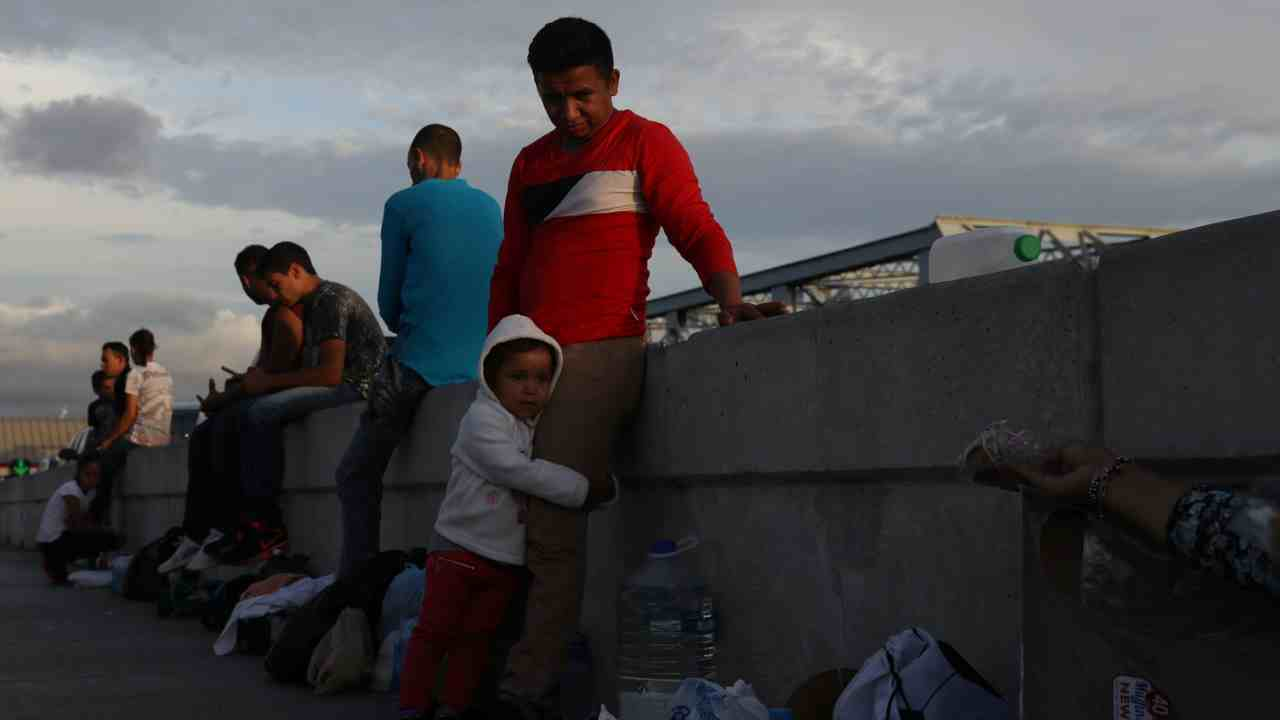 Asylum seekers wait on the Mexican side of the Brownsville & Matamoros International Bridge after being denied entry by US Customs and Border Protection officers near Brownsville, Texas, US. (Reuters)