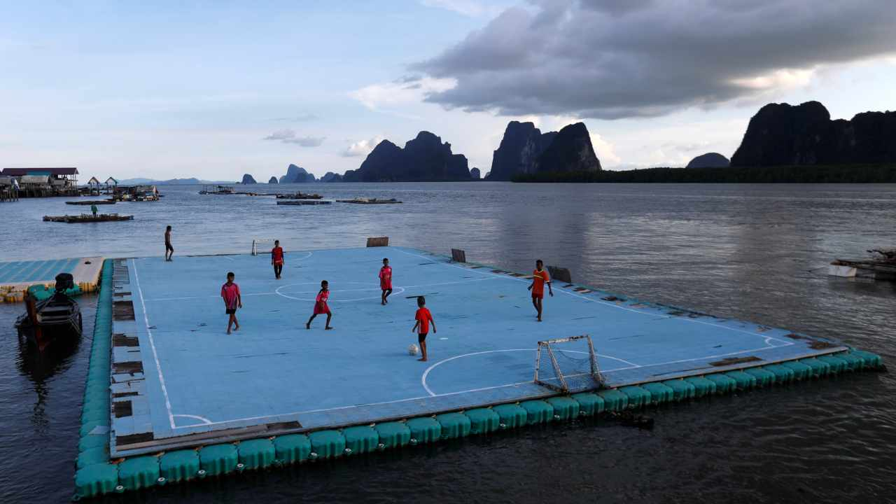 Children play soccer on a floating pitch in the fishing village of Ko Panyi in southern Phang Nga Province, Thailand. (Reuters).