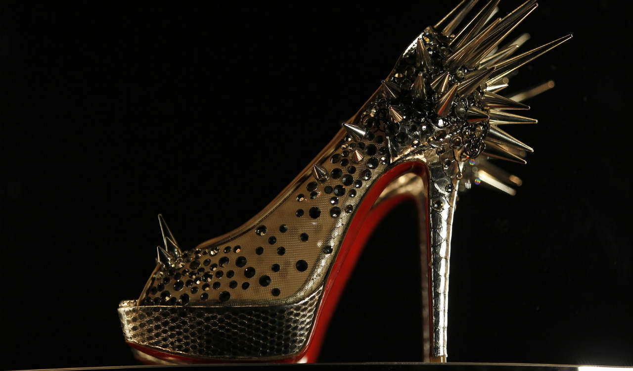 Q8. Identify this French fashion designer whose high-end stiletto footwear incorporates shiny, red-lacquered soles that have become his signature. Initially a freelance designer for fashion houses, he started his own shoe salon in Paris, with his shoes finding favour with celebrity clientele. Who is he? (Image: Reuters)