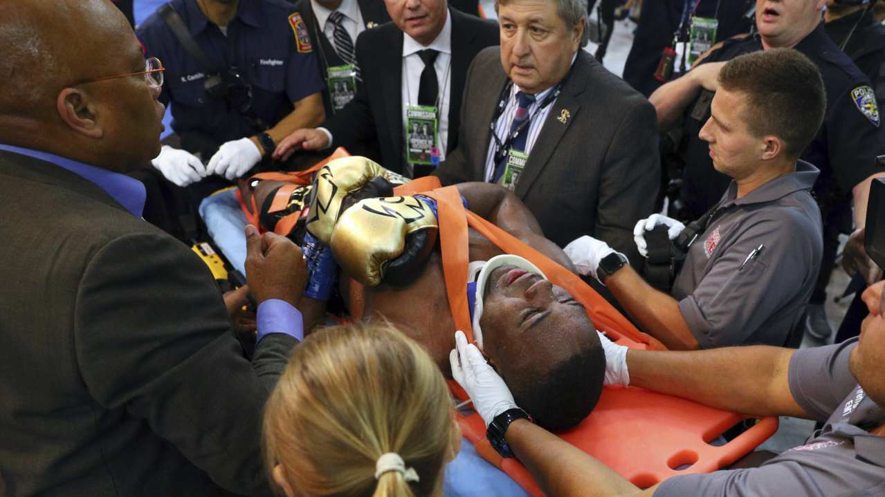 Javier Fortuna is led away on a stretcher after falling out of the ring during the fourth round against Adrian Granados in a boxing bout in Frisco, Texas. (AP/PTI)